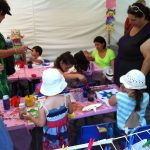 Mask art station at Moonee Valley festival